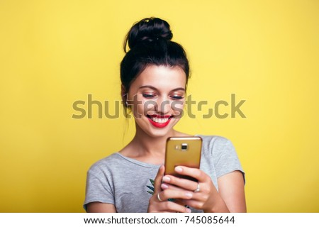 Close up of women's hands holding cell telephone with blank copy space scree for your advertising text message or promotional content, hipster girl watching video on mobile phone during coffee break Royalty-Free Stock Photo #745085644