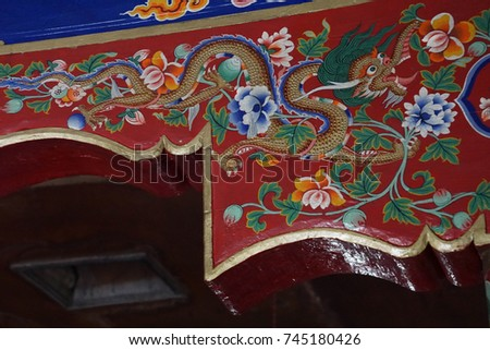 LADAKH, INDIA - SEP 12, 2017 - Painted dragon on wooden  beam in Liker Gompa Monastery, Ladakh, India #745180426