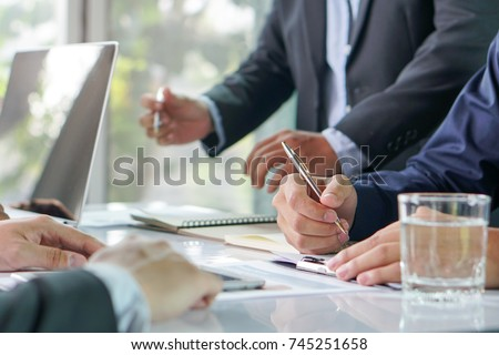 entrepreneurship new business start up meeting. Close up hand of young asian businessman taking note to notebook in the conference meeting for giving advice to new entrepreneurs. #745251658