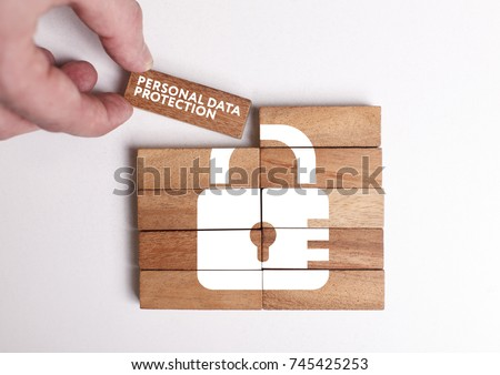 Business, Technology, Internet and network concept. Young businessman shows the word: Personal data protection Royalty-Free Stock Photo #745425253
