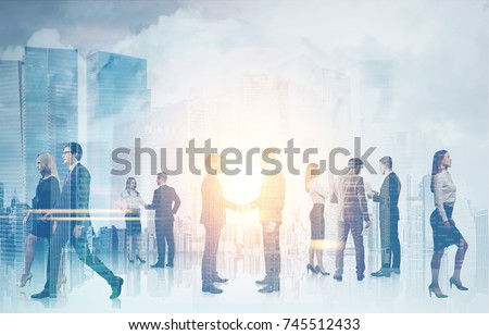 Business people silhouettes against a blurred cityscape background. Concept of a teamwork and communication. Double exposure toned image mock up #745512433