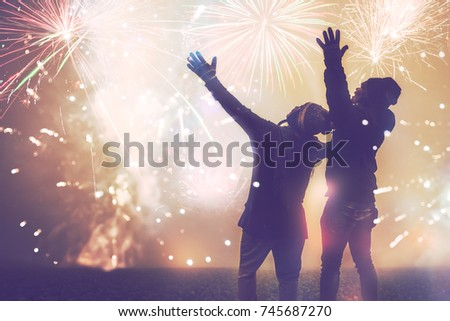 Lover women and men asians.Stand watch the fireworksIn New Year's Mountain. Thailand