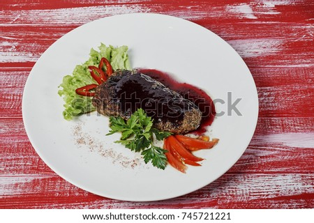 fried pork lined with slices on a plate, meat,salat,red paper,mustard #745721221