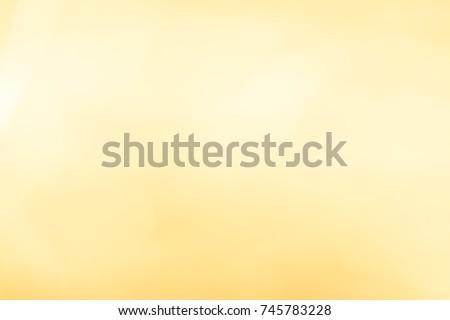 Xmas 2020 Golden transparent sparkles or glitter lights. Christmas festive gold background. Defocused lines bokeh or particles. Template for design #745783228
