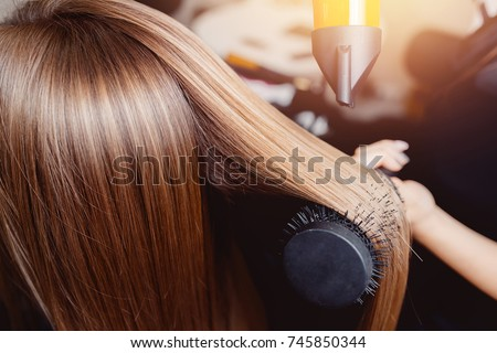 Close-up of hair dryer, concept cut salon, female stylist. Royalty-Free Stock Photo #745850344