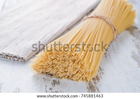 pasta on the wooden table for dinner #745881463
