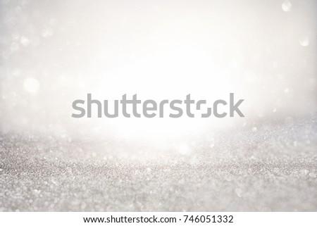 glitter vintage lights background. silver and white. de-focused. #746051332