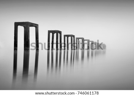 Fine art image in black & white of abandon jetty at Tumpat Kelantan, Malaysia. Soft Focus due to long exposure.