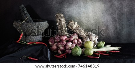 Still Life image of Mortar and pestle with spice for cook on black cloth and textures wall, Adjustment size for banner, cover, header and space for message #746148319