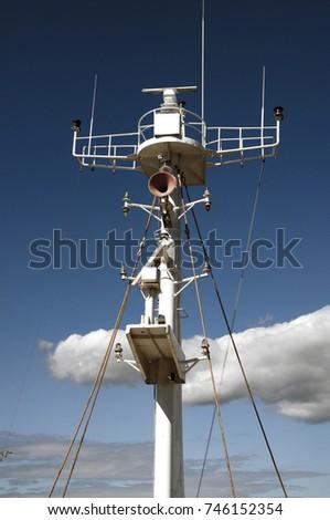 Maritime communication. Communication antenna. The antenna at the harbor. Blue sky. #746152354