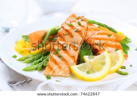 grilled salmon with asparagus, pea, yellow peppers, carrots and spring onions on white plate #74622847