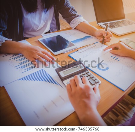 Business people discuss together about there work by graph document and setting in outdoor for planning financial strategy #746335768