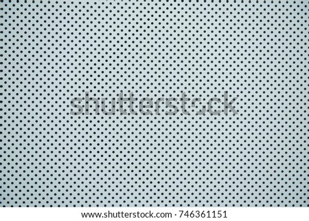 White corrugated metal texture surface for background. Halftone Dots Pattern. Metallic background with perforation of round holes #746361151
