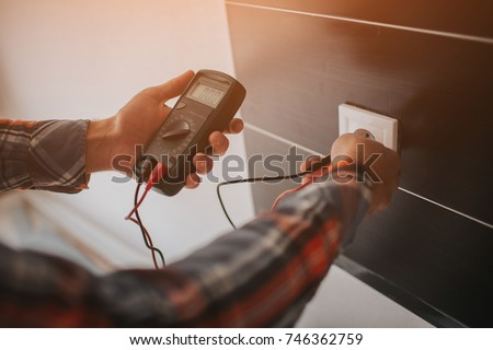 Electrician, Electrician installing new current socket with screwdriver. Installing electrical outlet or socket - closeup on electrician hands #746362759