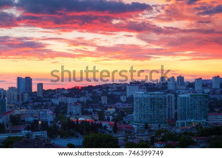 Aerial view of the Sochi city on the background of beautiful sky at sunset, Russia #746399749