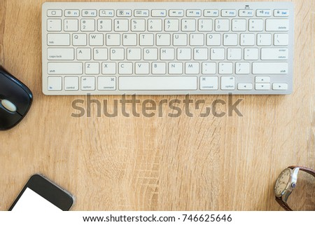 Working office desktop and wood table background with computer, smartphone. View from above with copy space #746625646