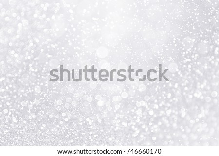 Elegant silver white glitter sparkle confetti background for happy birthday party invite, Christmas sale, falling winter snow, ice frost, frozen snowfall, 25th anniversary or shiny wedding bling glitz Royalty-Free Stock Photo #746660170