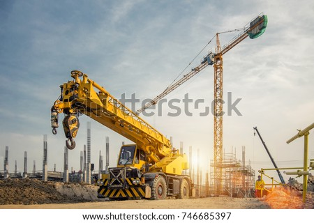 Mobile Crane on a road and tower crane in construction site #746685397