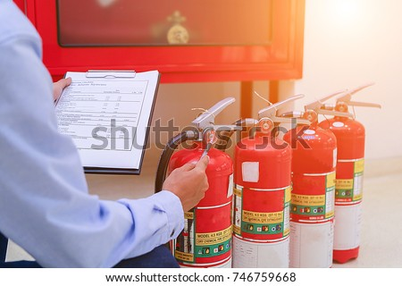 Engineer inspection Fire extinguisher and fire hose. #746759668
