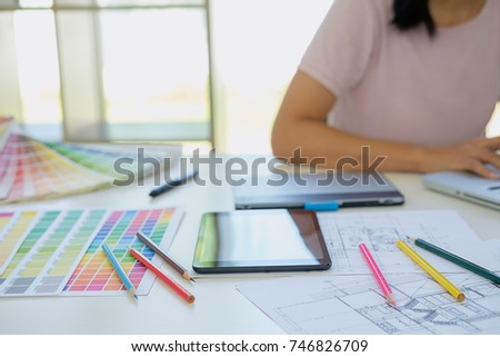 Graphic design and color  and pens on a desk. Architectural drawing with work tools and accessories #746826709