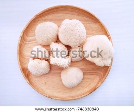 Monkey's head mushroom on wood dish with white background  Royalty-Free Stock Photo #746830840
