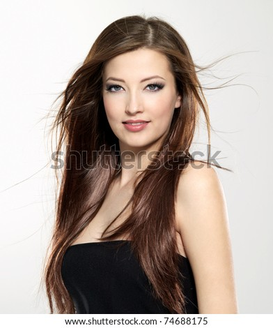 portrait of  beautiful sexy young woman with  long straight hair blowing on wind #74688175