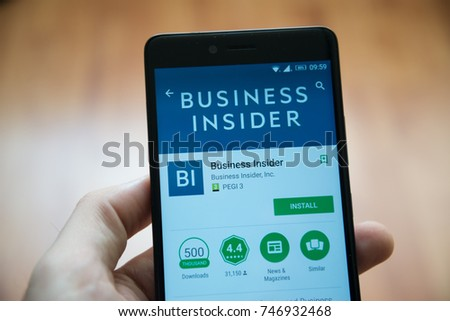 Los Angeles, november 2, 2017: Man hand holding smartphone with Business insider  application in google play store #746932468
