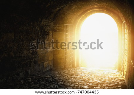 Door to Heaven. Arched passage open to heaven`s sky. Light at end of the tunnel. Hope metaphor. Royalty-Free Stock Photo #747004435