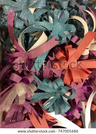 many various colorful ribbons in the box for decoration #747005686