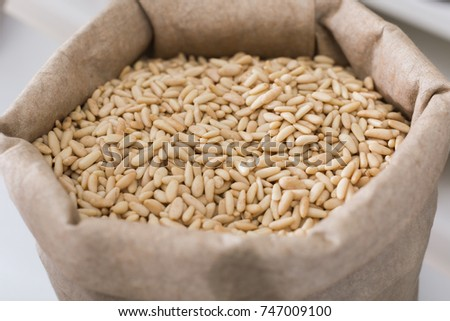 Image of white pine nut in container in the store. #747009100