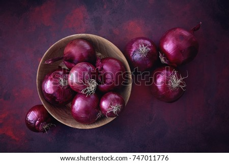 Red onions in a wooden bowl. Food Ingredients.  Royalty-Free Stock Photo #747011776