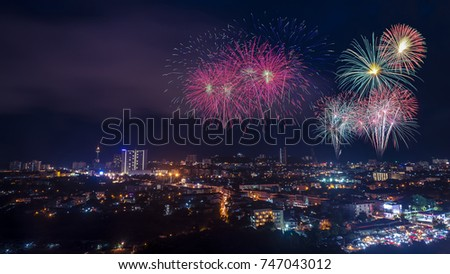 Fireworks in the city at night time. #747043012