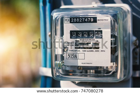 Watthour meter of electricity for use in home appliance with copy space.This is a modern technology that can monitor the home's electrical energy consumption.Electricity meter.Electronics #747080278