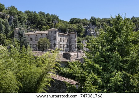 France, Auvergne-Rhone-Alpes, Vogue, river Ardeche: Skyline scenic panoramic view with famous ancient stone castle and homes of the French medieval small town with blue sky - concept history travel  #747081766