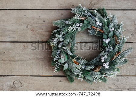 christmas wreath on wooden background. Christmas decor self made #747172498