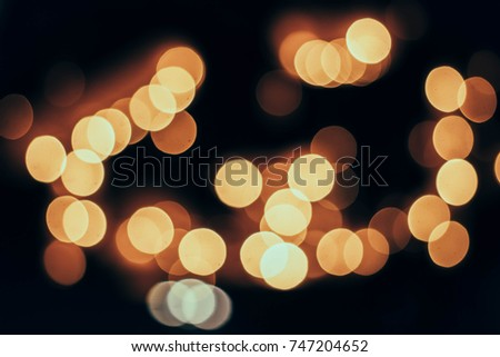 Christmas day with lights on trees and festive bokeh lights Blurred holiday backgrounds #747204652