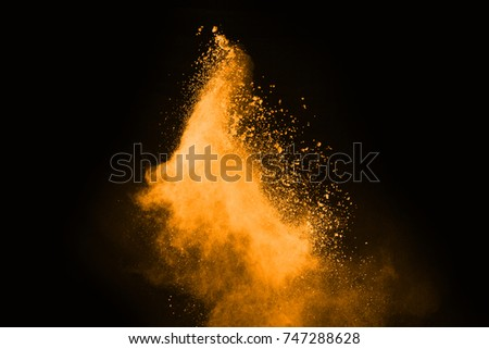 Abstract orange powder splatted background,Freeze motion of color powder exploding/throwing color powder,color glitter texture on black background. #747288628