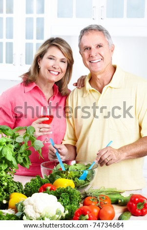 Happy seniors couple cooking at kitchen. Lifestyle. #74734684