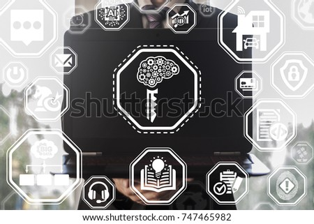 Businessman holds laptop with brain gear key icon on a virtual screen. Constructive Thinking Computing Technology. Creativity Success Business concept.