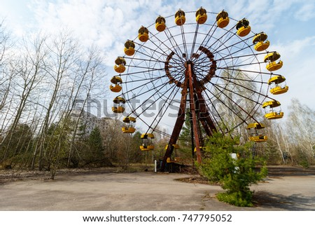 Chernobyl, UKRAINE - APR 5, 2017: Abandoned buildings of ghost town Pripyat during press tour to Chernobyl Zone  #747795052