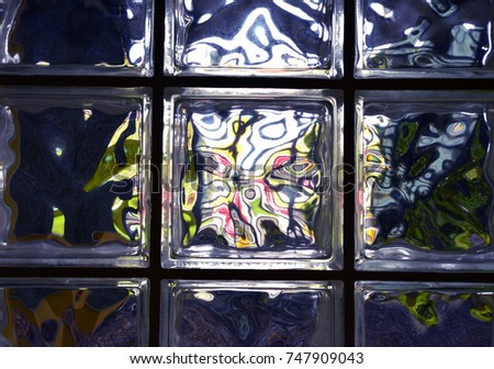 Glass Blocks Reflection Abstract (Clear Glass Blocks Inside a Building with Outdoor Reflections in Them) #747909043