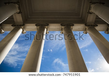 Building column on a government building with a beautiful blue sky. Royalty-Free Stock Photo #747951901