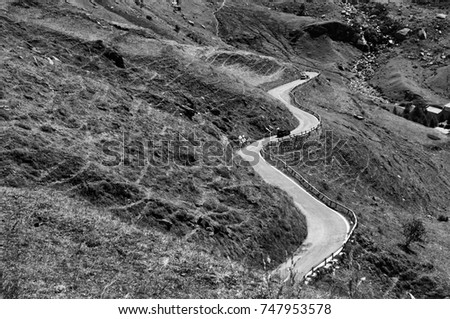 Landscape tourist path iconic winding curved road black and white picture Italy Piedmont Alps circa September 2013 #747953578