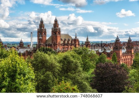 Kelvingrove Art Gallery, Glasgow, Scotland; 07 July 2017: Kelvingrove Art Gallery in Glasgow, Scotland. Towers, green spires and statue. #748068607