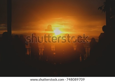 many shadow of people is shooting sunrise with their camera  for advertising,silhouette concept or sunrise concept #748089709