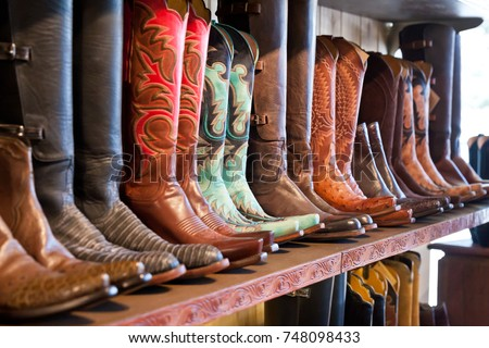 Cowboys boots on a shelf in a store, aligned  #748098433