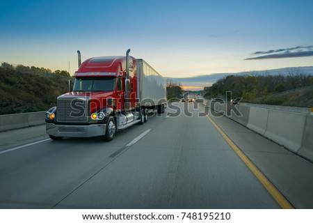 Big red semi truck on highway #748195210