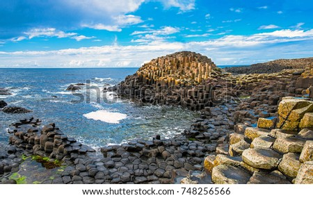 Landscape of Giant's Causeway trail with a blue sky in summer in Northern Ireland in United Kingdom. UNESCO heritage. Royalty-Free Stock Photo #748256566
