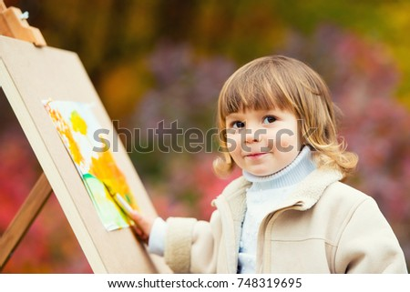 Autumn Baby Girl Drawing in Fall Leaves Park, Little Kid Painting, Children Creativity