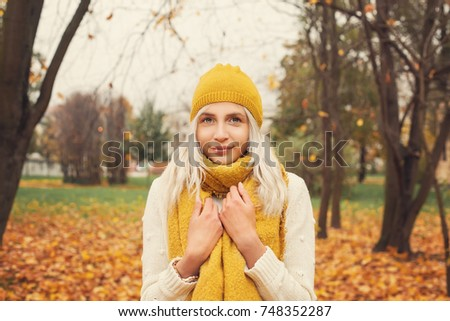 Pretty Girl in the Autumn Park Outdoors #748352287